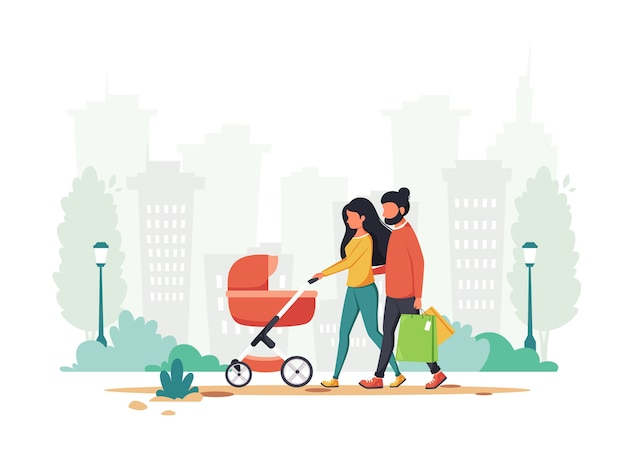 Family with baby carriage walking in the park.