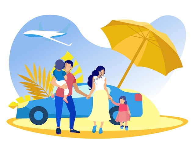 Family with boy and girl on beach under umbrella.