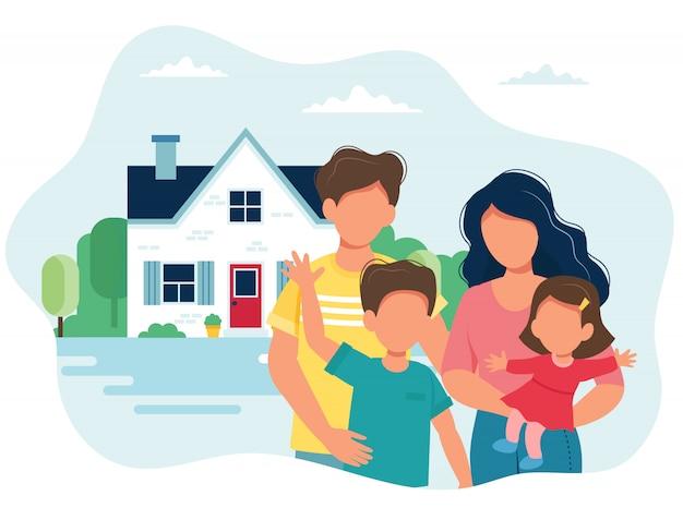 子供連れの家族とかわいい家。