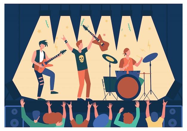 Знаменитая рок-группа играет музыку и поет на сцене