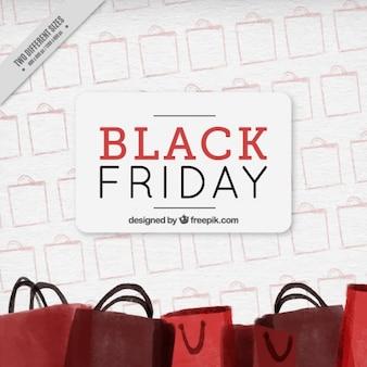 Fantastico sfondo con sacchetti rossi per venerdì nero