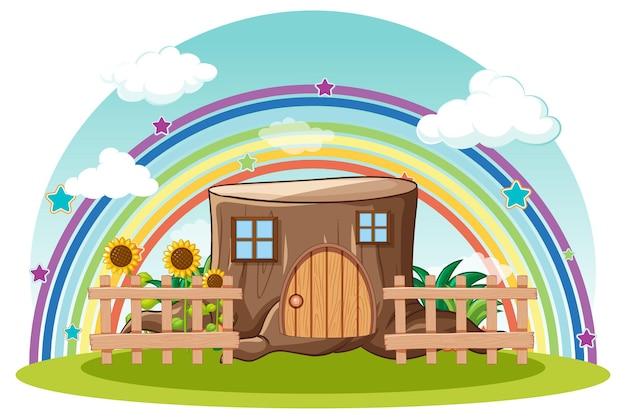 Casa di tronchi di fantasia con arcobaleno nel cielo