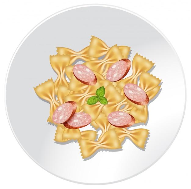 皿にソーセージを入れたfarfalle pasta