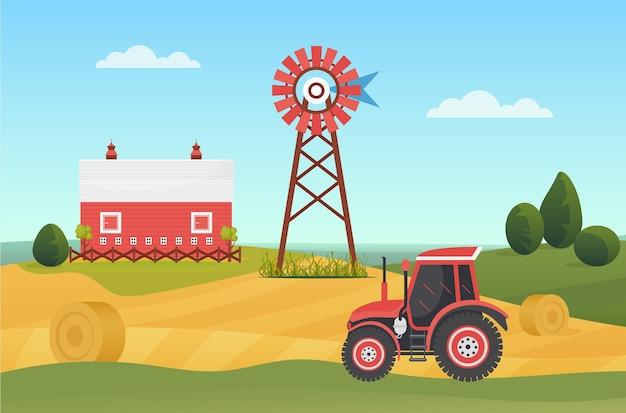 干し草の山のある村の土地の田園地帯の牧場の風景に農業用トラクターを耕作する