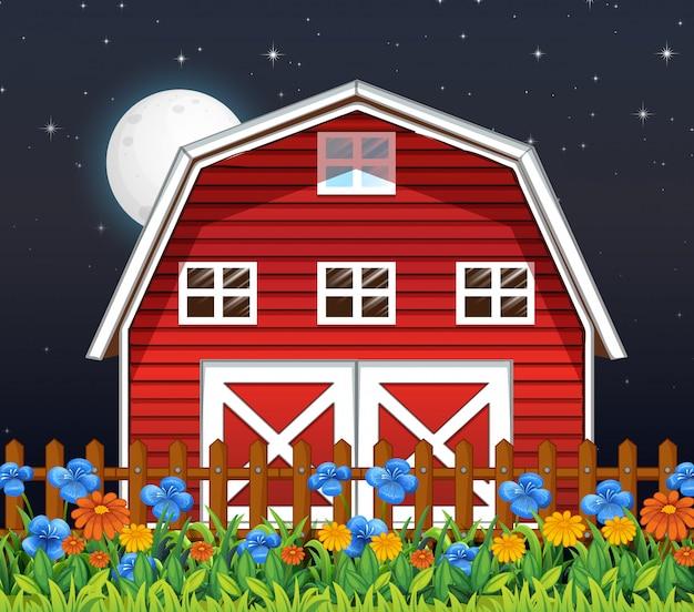 밤에 농장 헛간과 꽃