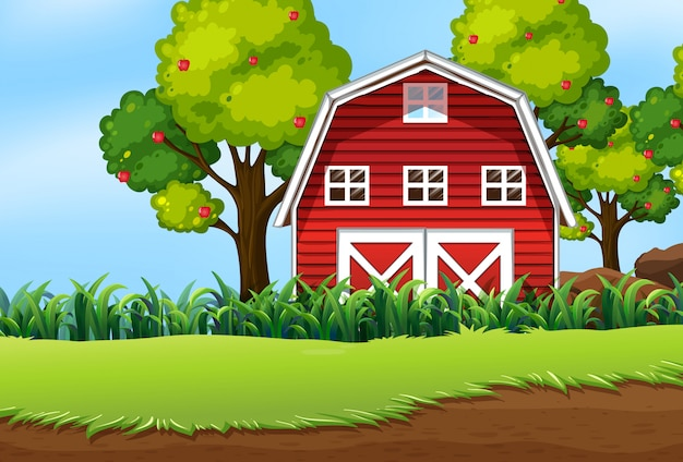 納屋とリンゴの木と自然の風景の中の農場