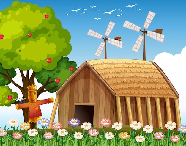 헛간과 허수아비와 풍차가있는 자연 현장의 농장