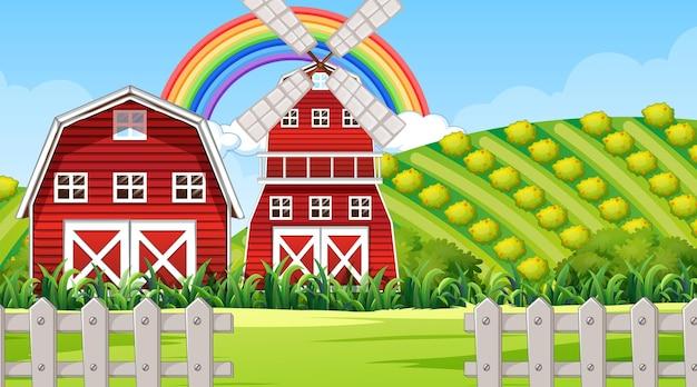 Scena di paesaggio agricolo con fienile e mulino a vento