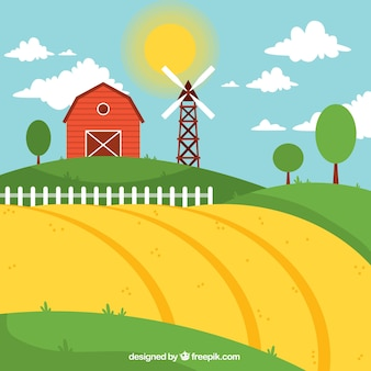 Farm landscape with red barn in a sanny day