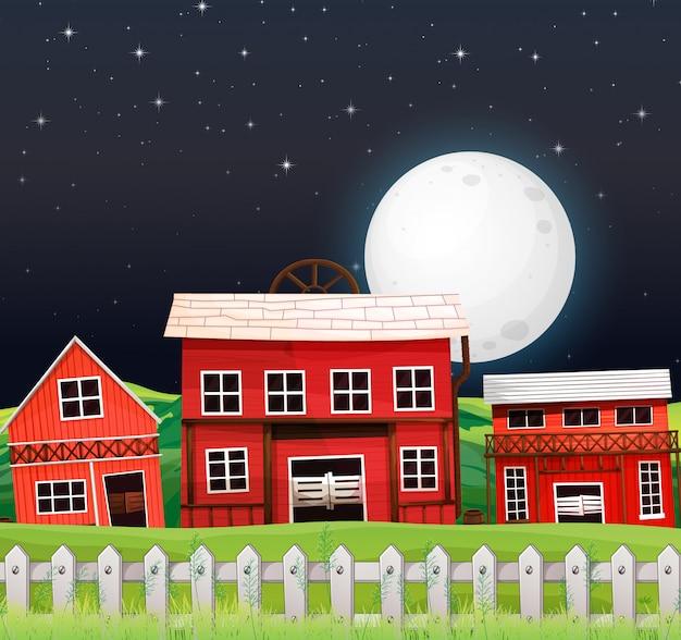 Farm scene with barn and farm house at night