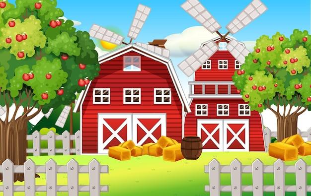 Scena di fattoria con fienile rosso e mulino a vento