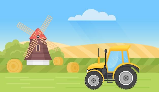 Сельскохозяйственный трактор в летней деревне пейзаж сельской местности с полями стога сена мельницы