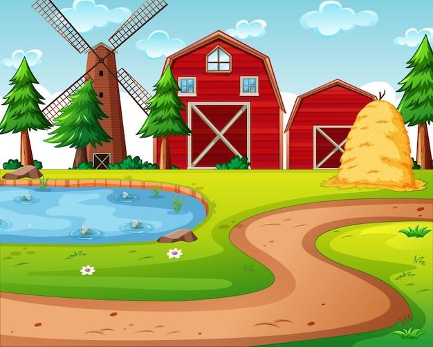 赤い納屋と風車のシーンのある農場