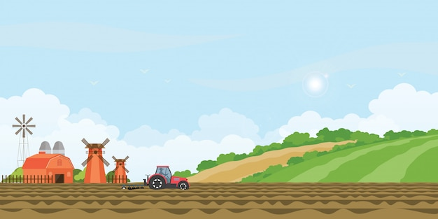 Farmer driving a tractor in farmed land and farmhouse.