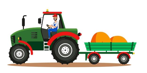 Фермер за рулем трактора с тюками сена в тележке