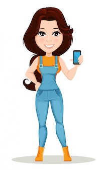 Farmer girl dressed in work jumpsuit holds smartphone
