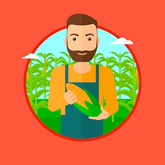 Farmer holding corn.