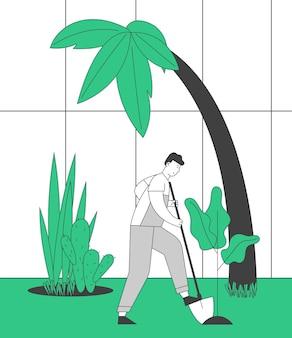 온실에서 토양을 파고 식물을 돌보는 정원에서 일하는 작업 바지의 농부 남자