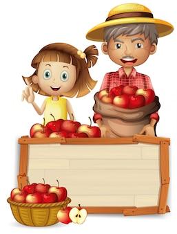 Farmer with apple on wooden baord