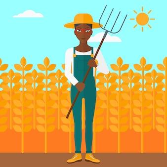 Farmer with pitchfork.