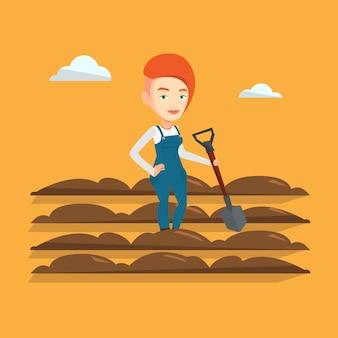 Farmer with shovel at field