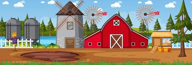 Горизонтальная сцена сельхозугодий с сараем и ветряной мельницей в дневное время
