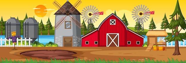 Горизонтальная сцена сельхозугодий с сараем и ветряной мельницей во время заката