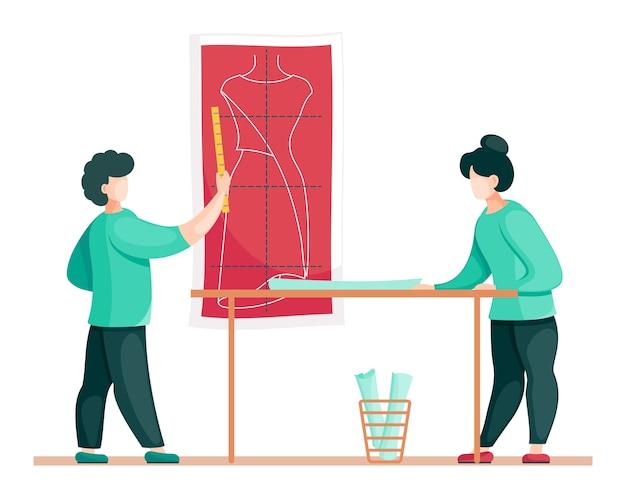 ファッションデザイナーがテーブルの近くに立っています