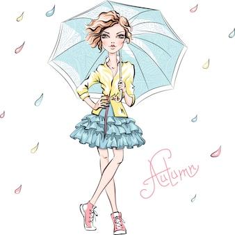秋の服のファッションの女の子