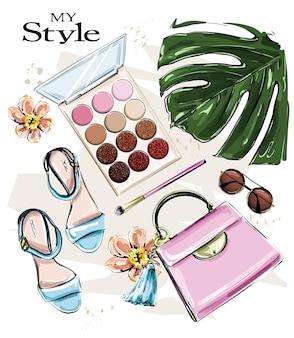 Fashion set with sandals bag sunglasses and eye shadows
