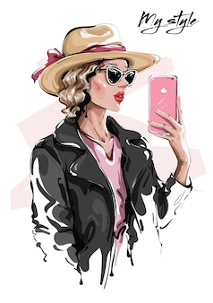 Fashion woman in hat making selfie