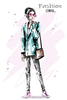 Женщина моды с сумочкой