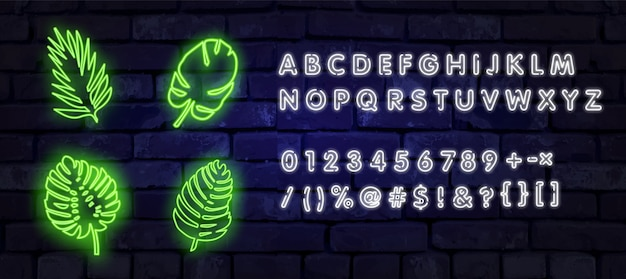 Fashionable neon sign for cafes and bars, restaurants. neon glowing tropical leaves for your design. neon sign, palm leaf against a brick wall.