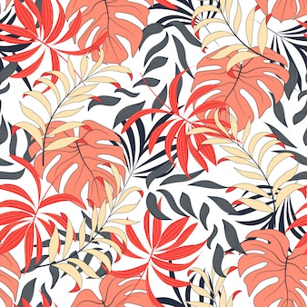 Fashionable seamless tropical pattern with bright blue and pink plants and leaves