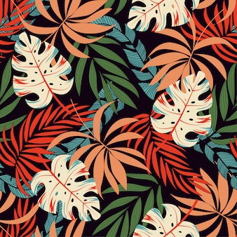 Fashionable seamless tropical pattern with bright pink and yellow plants and leaves