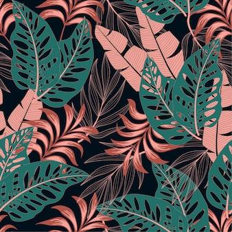 明るい植物と葉を持つファッショナブルなシームレスな熱帯パターン