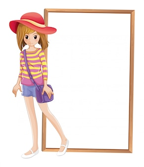 A fashionable teenager in front of the empty frame