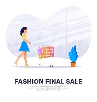 割引の最終日に買い物をするファッショナブルな女性。