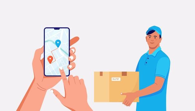 カートンボックス付きの高速宅配便。配達追跡食品または小包のためのモバイルアプリを備えたスマートフォン。制服を着た配達人