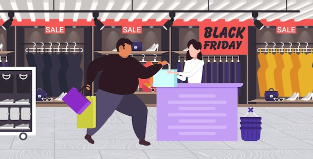 Fat man buying clothes at cash desk with female cashier black friday big sale