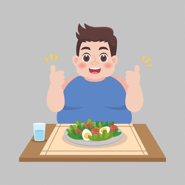野菜サラダを食べる準備ができているデブ男