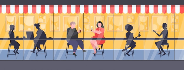 Fat obese couple drinking coffee discussing during meeting men women silhouettes sitting at counter desk obesity concept modern street cafe exterior