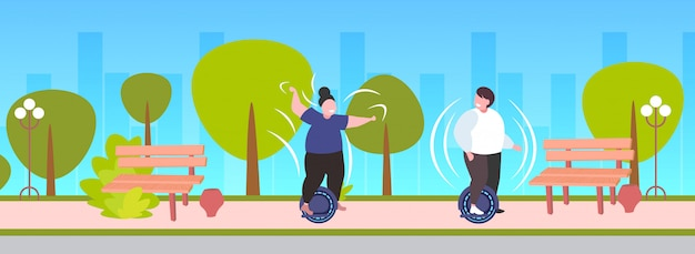 Fat obese man woman riding self balancing scooter couple standing on electric gyroscooter personal electrical transport obesity concept urban park landscape