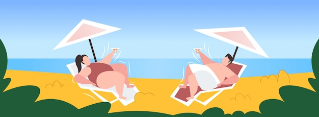 Fat obese man woman sunbathing overweight couple drinking cocktail lying on sun lounger under umbrella unhealthy lifestyle obesity concept seaside
