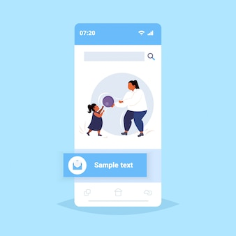 Fat obese mother with daughter playing with ball overweight woman and child having fun together weight loss physical activity concept smartphone screen online mobile app  full length