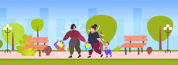 Fat obese women with child holding shopping bags overweight girls walking with little boy outdoor big sale obesity concept public park cityscape
