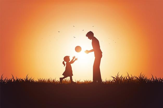 Отец и его дочь ребенок девочка, играя на открытом воздухе с закатом