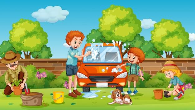 父と息子が庭で車を掃除