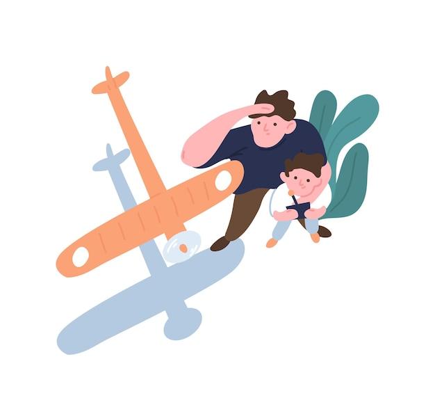 아버지와 아들 발사 모형 항공기. 장난감 비행기, 에어로 모델 또는 글라이더의 비행을 보는 아빠와 아이