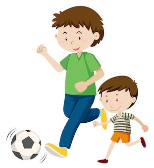 Отец и сын играют в футбол